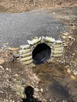 Tu as bien mis le ciment autour du drain ?