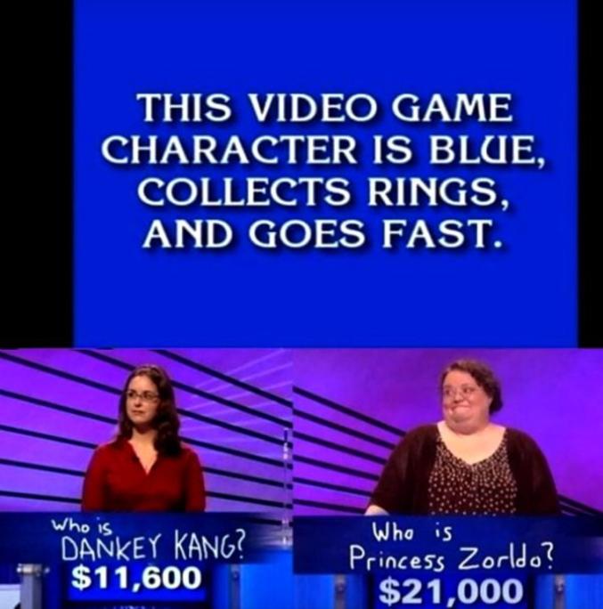 """C'est dans le jeu Jeopardy! (oui avec un !) . Le principe, à partir de réponses communément appelés des indices, trois candidats doivent trouver la question correspondante. Chaque bonne réponse (c'est-à-dire chaque bonne question) rapporte une somme, chaque erreur la fait perdre. Ils peuvent choisir entre six catégories et cinq valeurs d'indices par catégorie.  Ici, """"quel personnage de jeu vidéo bleu, collecte les anneaux et cours vite?"""" Je suppose que la plus part d'entre vous ont deviné qu'il s'agissait de Sonic mais quand on voit ces 2 grosses connes (celle de droite aussi bien au sens propre qu'au figuré) se tromper, non seulement de personnage mais aussi d'orthographe, on ne peut qu'avoir honte pour elle.   Mais bon ça fait quand même sourire un peu.  :)"""