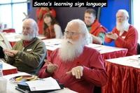 Pères Noël apprenant la langue des signes
