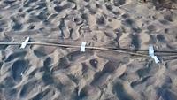 Un câble dans le sable