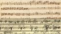 Partition manuscrite de Mozart, puis de Beethoven.